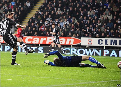 Newcastle's Peter Lovenkrands slots home after Edwin van der Sar spills Jonas Gutierrez's shot