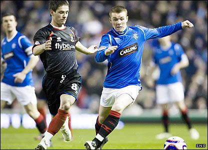Ian Black challenges Rangers's John Fleck