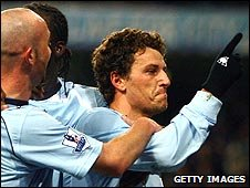 Elano (right) is congratulated after scoring