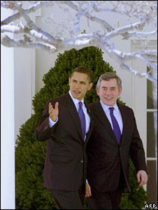 Barack Obama and Gordon Brown walk in the grounds of the White House