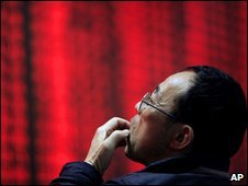 Investor looks at share prices in Shanghai