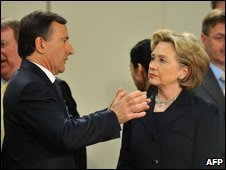 Italian Foreign Minister Franco Frattini talks to US Secretary of State Hillary Clinton at Nato headquarters, 5 March