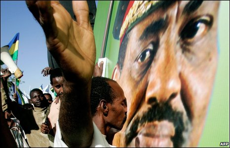 A Sudanese man kisses a picture of President Bashir in Khartoum, 5 March