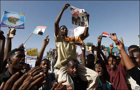 Sudanese demonstrators burn a crossed-out ICC poster in Khartoum, 4 March