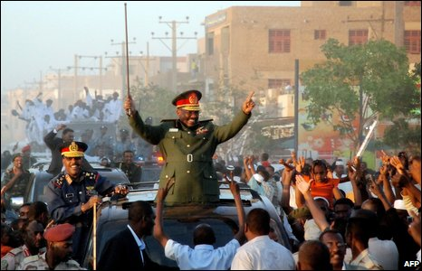 Sudanese President Omar al-Bashir greets supporters in Khartoum, 4 March