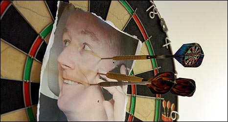 Fred Goodwin picture on a dartboard