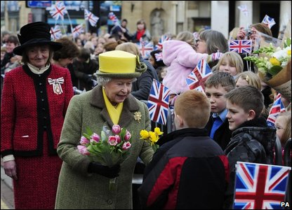The Queen receives flowers from children
