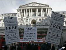 Three demonstrators outside the Bank of England