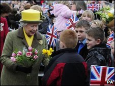 The Queen receives flowers as she arrives in Hull