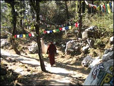 A monk walks a long a path in Dharamsala (Image: Eleanor Thomas)