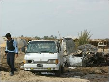 Damaged vehicles at the bomb blast site near Hilla