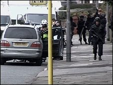 Officers outside the factory in St Helens
