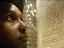 Rageh Omaar looks at a fragment of biblical text, file image