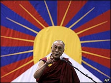 Dalai Lama framed by the Tibetan flag (file photo)