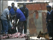 A body is removed after fighting between police and a Mungiki mob in Nairobi, June 2007