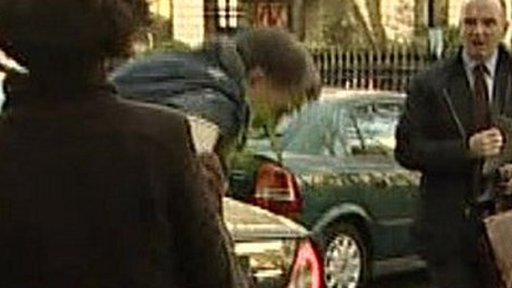Lord Mandelson having green custard thrown over him