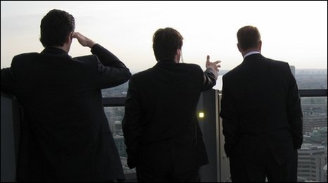 Men view city skyline