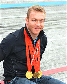 Sir Chris Hoy with his three Beijing Olympic golds