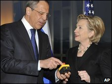 US Secretary of State Hillary Clinton presents Foreign Minister Sergei Lavrov with a mock reset button