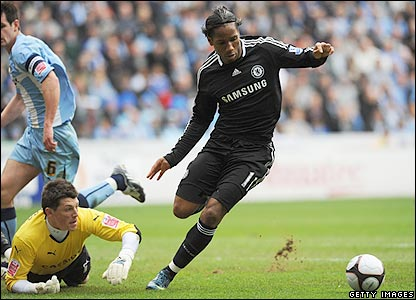 Drogba rounds Kieran Westwood before giving Chelsea the lead