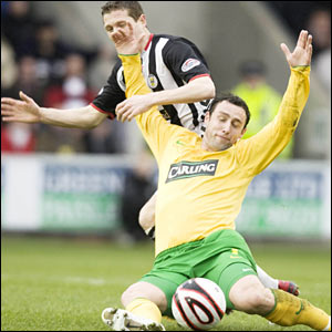 Celtic's Scott McDonald (below) crashes to the turf courtesy of a Hugh Murray challenge