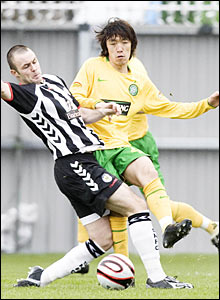 Will Haining (left) puts a challenge in on Celtic's Shunsuke Nakamura