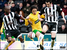 Shunsuke Nakamura (centre) battles for possession with St Mirren pair Mo Camara and Jack Ross (right)