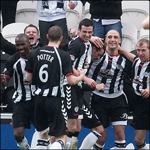 Billy Mehmet is mobbed by his team-mates after putting St Mirren ahead