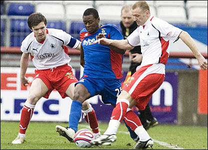 Eric Odhiambo (centre) closes down Falkirk's Lee Bullen as Darren Barr looks on (left)