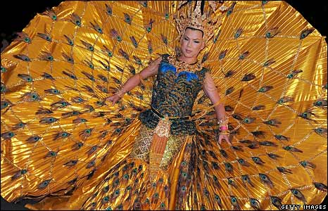 A Thai drag queen in a peacock costume