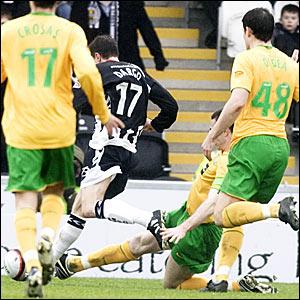 Stephen McManus (partially hidden) slides in to bring down St Mirren's Craig Dargo (17) for a penalty