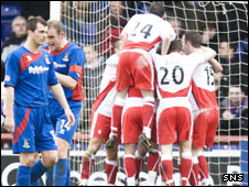 Falkirk celebrate Carl Finnigan's first half penalty goal