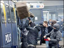 Protesters throw stones at police vans in Malmo, Sweden