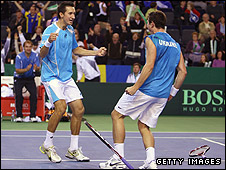 Stakhovsky (left) and Bubka celebrate their doubles win in Glasgow
