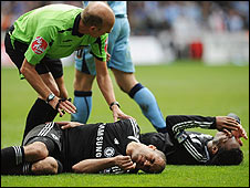 Steve Bennett looks on as Alex and Drogba lie injured