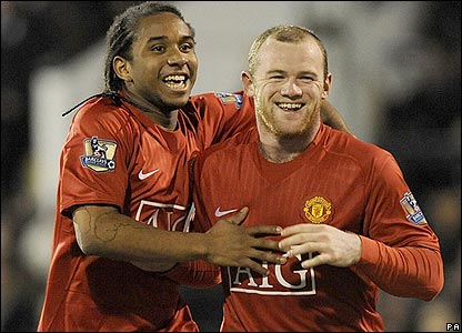 Anderson and Rooney celebrate the third goal