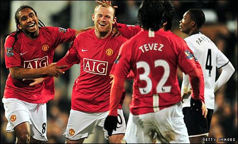 Manchester United players celebrate their third goal