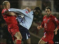 Nathan Elder (centre) in action against Accrington