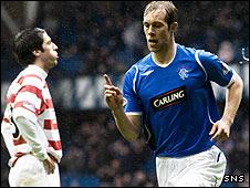 Steven Whittaker celebrates his early goal