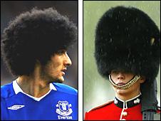 Marouane Fellaini and a guard wearing a bearskin