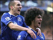 Leon Osman and Marouane Fellaini celebrate Everton's equaliser