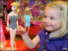 Child with Barbie in a London store