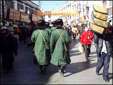 Chinese security forces patrolling Lhasa earlier this year