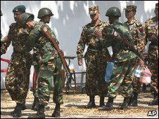 Soldiers search border guards returning for duty in Dhaka.