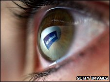 Facebook reflected in human eye, Getty