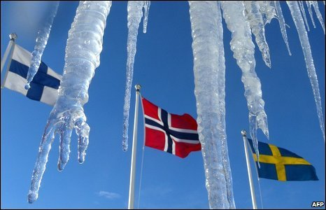 From the left, the flags of Finland, Norway and Sweden are seen behind icicles in Sweden, 9 March 2009