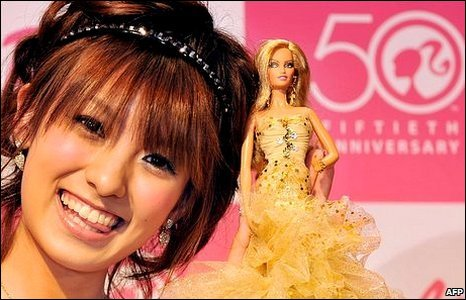 Actress Akina Minami shows off the 50th anniversary model of Barbie in Tokyo, Japan, 9 March 2009