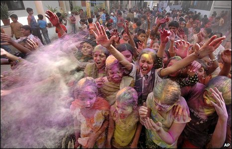 Children throw coloured powder in Ahmadabad, India, 9 March 2009