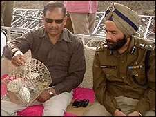 Senior Superintendant Arshinder Singh Chawla (L) with the rats.