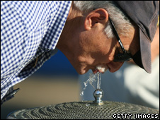 Man drinking from a water fountain (Getty Images)